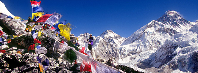 Hiker and prayer flags and Everest views at Mt. Everest  Base Camp in Nepal