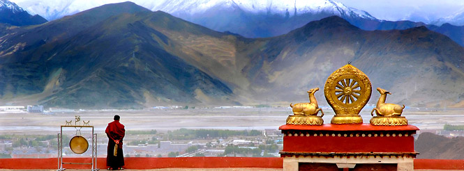 TIbetan monk on a monastery rooftop in Tibet
