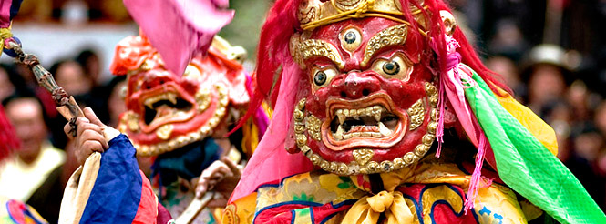 Dancer wearing large mask of Buddhist deity in Kham, eastern TIbet.