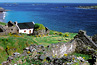 people walking along bluff on blasket island ireland