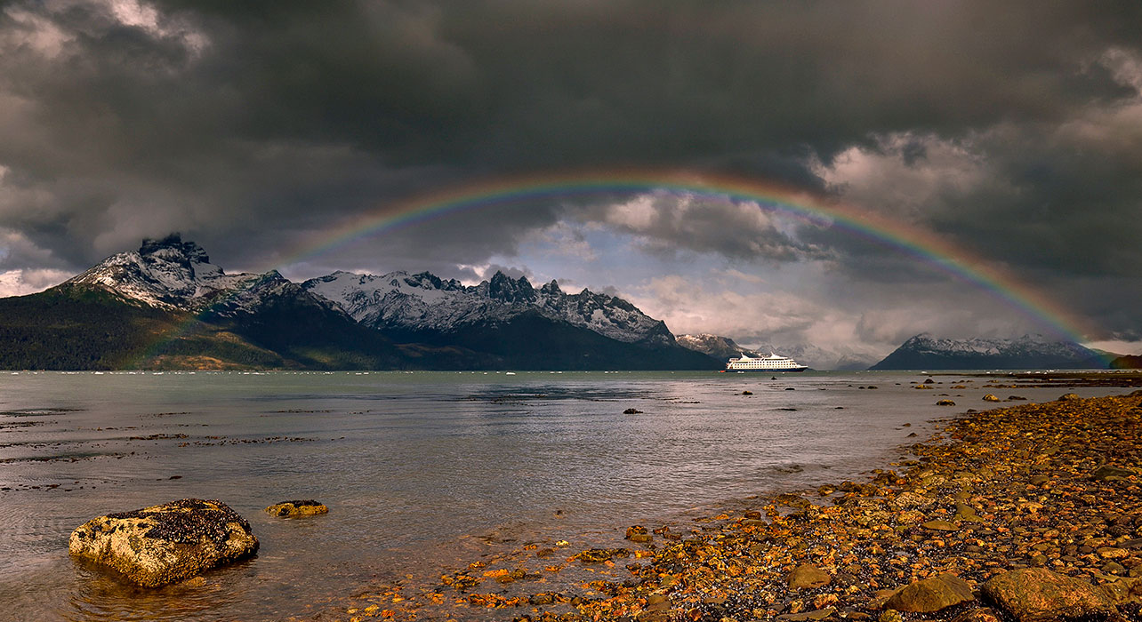 patagonia cruise ship under rainbow