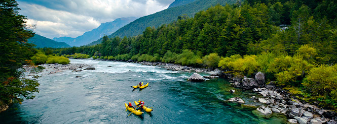 Three kayakers paddling on the Futaleufu River in southern Chile